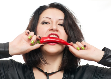 girl holds her lips red hot pepper photo