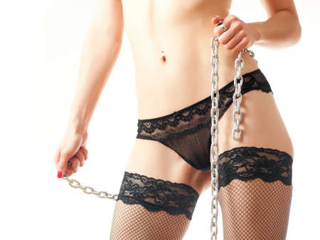 young girl in underwear holding a steel chain on a white background photo
