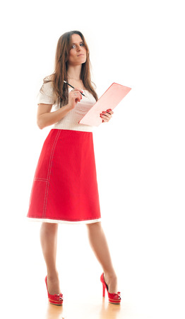 attractive young businesswoman making notes in her binder on a white background 版權商用圖片