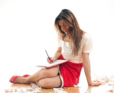 attractive young woman editor making notes in her binderbackground on a white