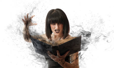 evil woman casts a black magic book. witch with a book on white background photo