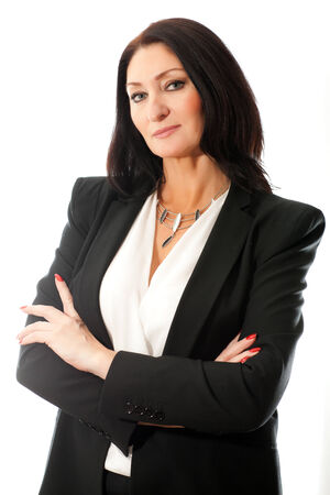 adult beautiful business woman in a jacket with arms crossed on a white background photo