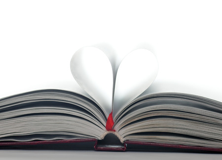 Pages of a book made into a heart shape  Symbolizes a love of books, reading and education, or romance  photo