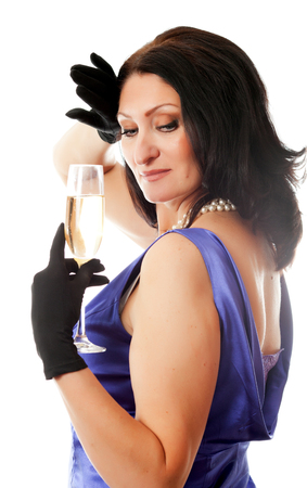 beautiful adult woman with glass of wine on a white background photo