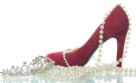 red suede womens shoes and pearl beads on white  photo