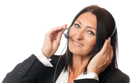 handsfree device: face of a beautiful adult woman in headphones on a white background