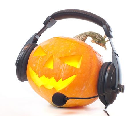 A jack O Lantern on white. pumpkin with headphones on white background