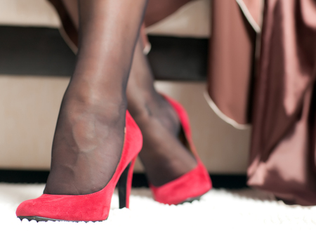 foot fetish: graceful female legs in red shoes with high heels closeup Stock Photo