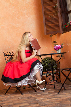 screenwriter: beautiful young woman with a notebook sitting at a table