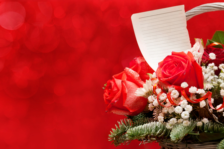red rose bokeh: Bouquet of flowers with a note on a red background with beautiful bokeh