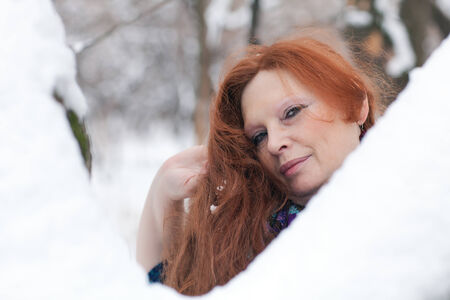 long red hair: beautiful adult woman with long red hair in winter Stock Photo