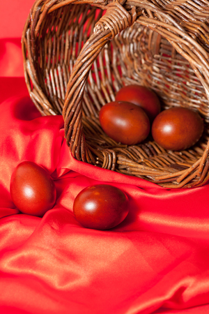 sateen: beautiful easter eggs on red cloth closeup Stock Photo