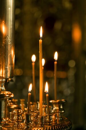 votive candle: Burning candles in a church on a blurred background