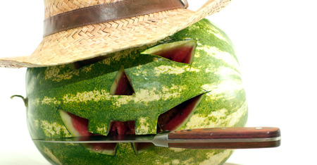 Watermelon with carved face on it on a white Stock Photo