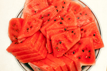 sliced watermelon: Red sliced watermelon lying on a tray