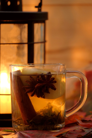 tea lamp: Glass cup of tea and candle lamp on the table Stock Photo