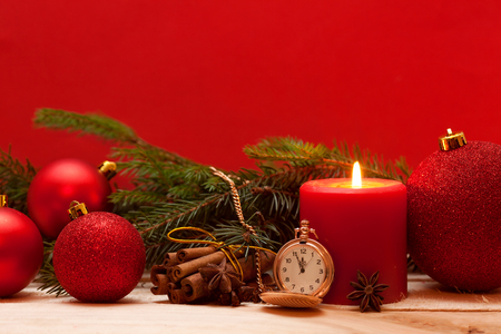 Red candle, pocket Watches, and Christmas ball red background