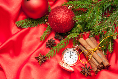 sateen: Pocket watches, Christmas balls and spruce branches on a red