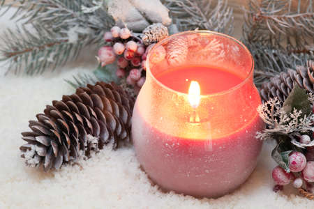 snow cone: Red candle, spruce and pine cone on the snow Stock Photo