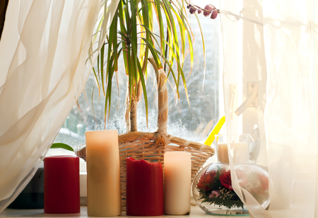 windowsill: Large candles on the windowsill winter morning Stock Photo