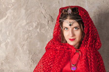 lamia: Young woman with a red kerchief on her head