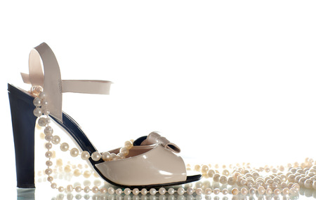 no heels: Sandals and pearl beads on white background