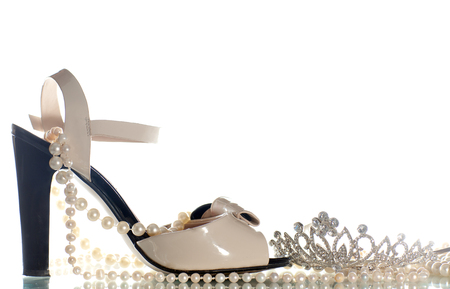 no heels: Sandals, diadem and pearl beads on white background