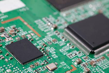 backdop: Processor on the motherboard closeup. Macro photo card