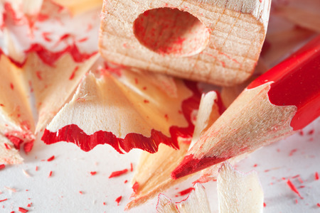 office appliances: Red pencil and sharpener close-up. Photos office appliances Stock Photo