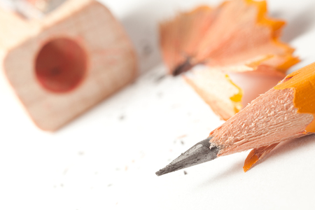 Gray pencil and sharpener close-up. Photos office appliances