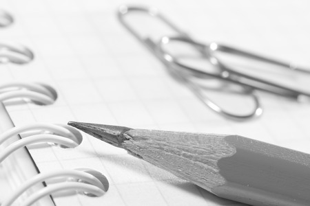 Pencil on notebook sheet closeup. Photos office appliances Stock Photo