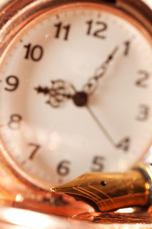 pocket watch: Gold fountain pen and pocket watch close-up