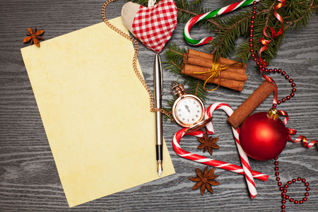 Christmas candies, paper and spruce branch on the table
