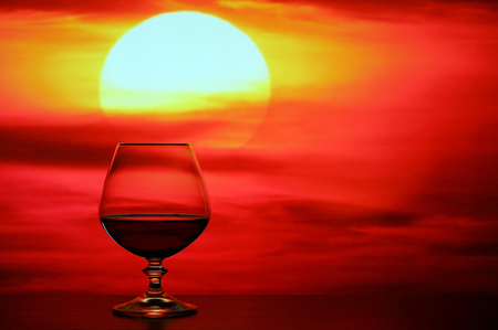 elite: Brandy glass on a background of beautiful red sunset