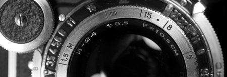 Lens of old retro camera closeup. Vintage camera.