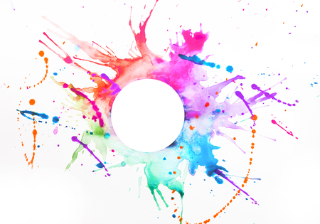 Multicolored paint on a white sheet of paper