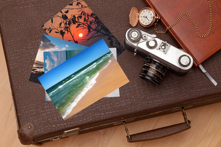 Photos and an old retro camera on a suitcase  Stock Photo