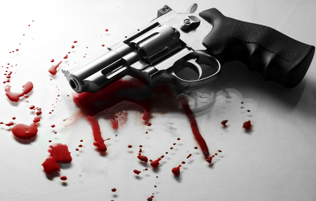 Beautiful revolver and red blood on a white Stock Photo