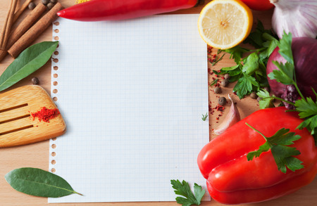 the recipe to write down: Ingredients for a dish and a sheet of paper on a table