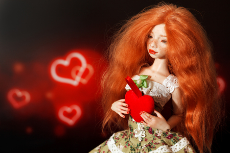 Red-haired doll and heart on a beautiful background Stok Fotoğraf
