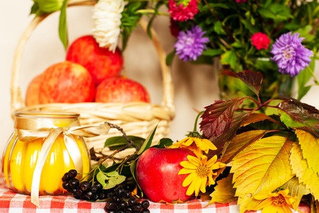 Autumn composition of apples and flowers on the table Stock Photo