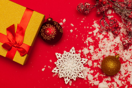 Christmas balls and gift on a red background Stock Photo