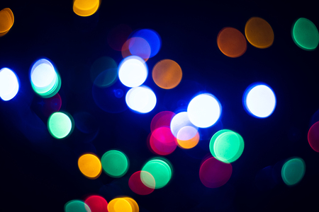 Abstract multicolored bokeh background. Colored glitter vintage lights background. Фото со стока