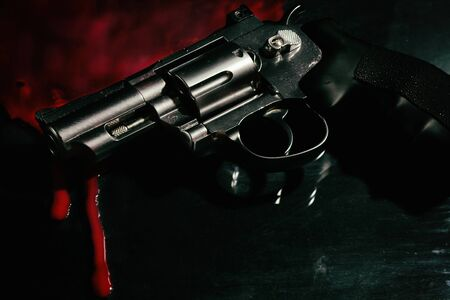 Beautiful revolver and red blood on a black 免版税图像