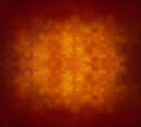 abstract orange background with bokeh. Colored glitter vintage lights background.