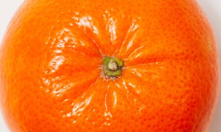 closeup photo of ripe orange mandarin in peel  版權商用圖片