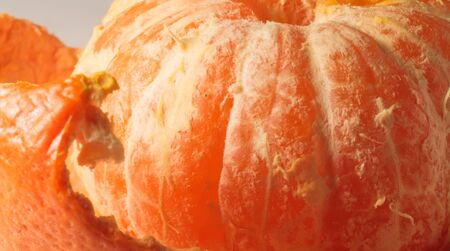 photo of ripe close-up beautiful ripe orange mandarin peeled 版權商用圖片