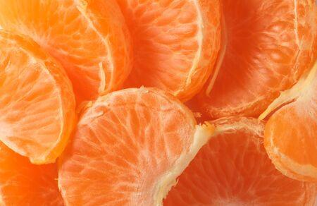 photo of ripe orange juicy ripe mandarin slices close-up 版權商用圖片