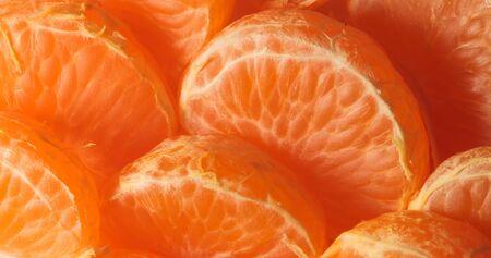 photo of ripe orange juicy ripe mandarin slices close-up