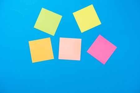 colored stickers for notes on a blue background